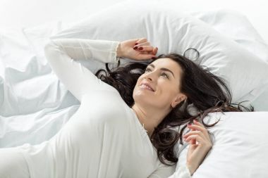 woman in sleepwear awakening