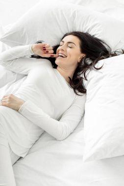 woman in sleepwear awakening