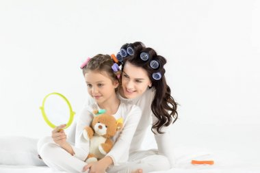 Mother and daughter in curlers