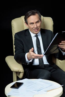 Mature businessman in chair
