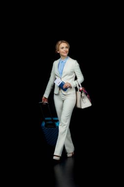 blonde businesswoman with suitcase