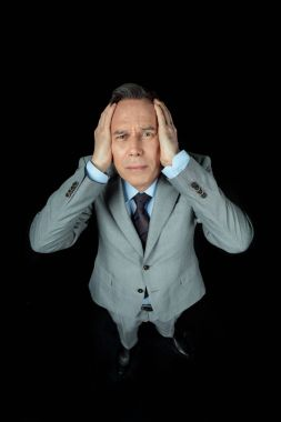 middle aged frightened businessman