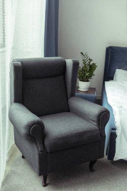 modern armchair in bedroom