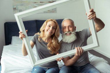 middle aged couple with white frame