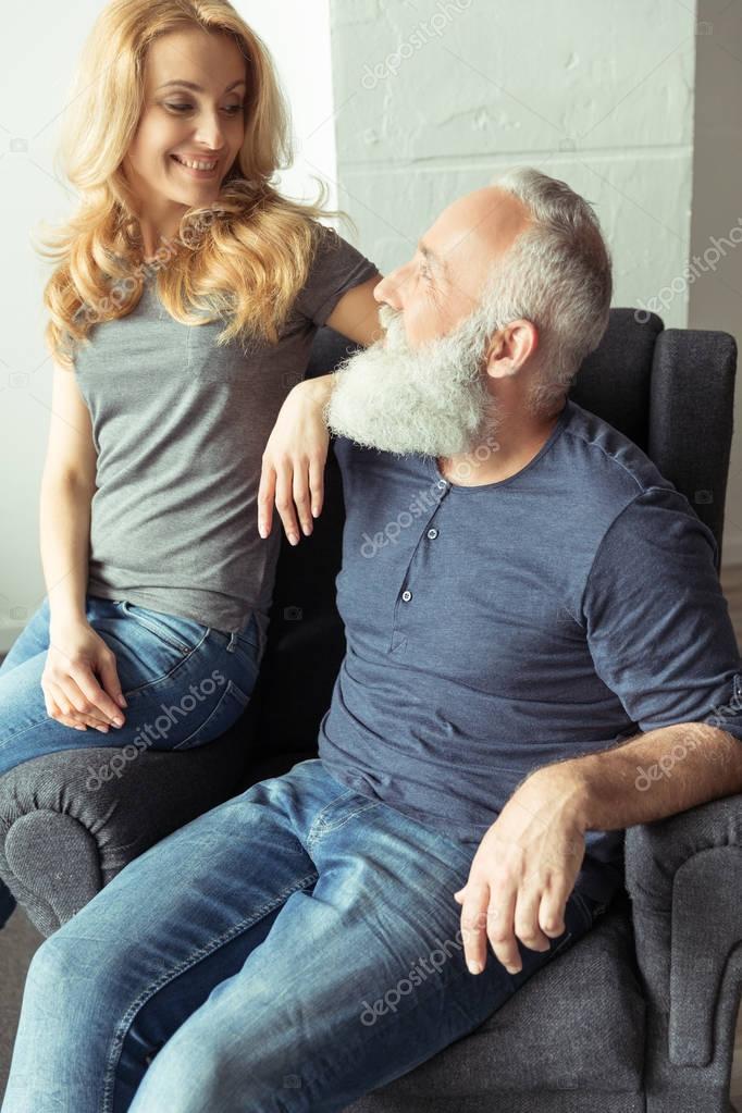 Couple sitting on armchair