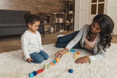 Mother and daughter playing with cubes