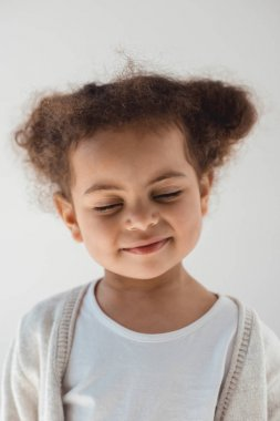 little kid girl with eyes closed
