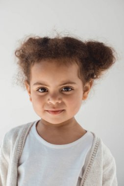 little kid girl looking at camera