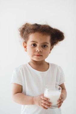 kid girl holding glass of milk