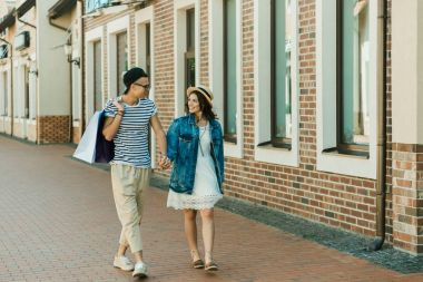 stylish couple with shopping bags