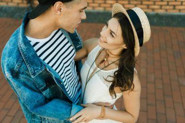 Stylish couple hugging on the street