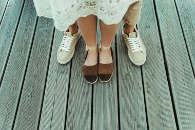 couple standing together on wooden floor
