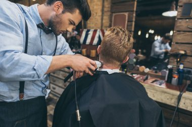 barber cutting hair of customer