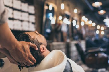 hairstylist washing clients hair