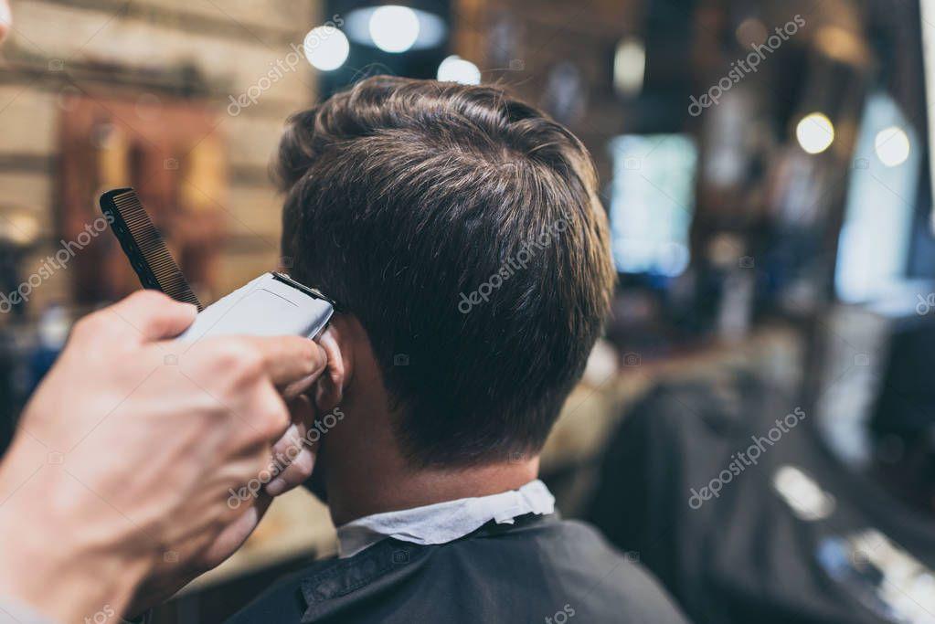 barber cutting hair of customer