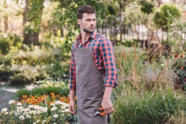 gardener with pruning shears in garden