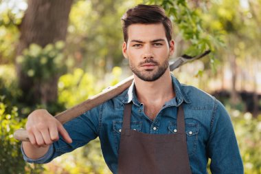 gardener with spade in garden