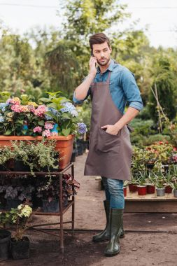 gardener with smartphone in garden