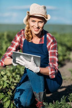 farmer working with digital tablet