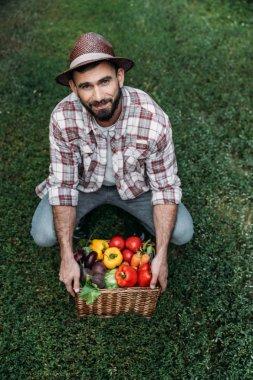 farmer holding basket with vegetables