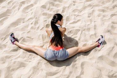 sportswoman doing split