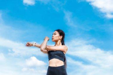 sportswoman stretching hands