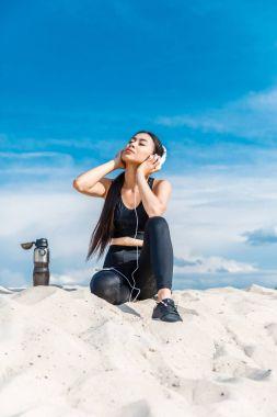 sportswoman listening music
