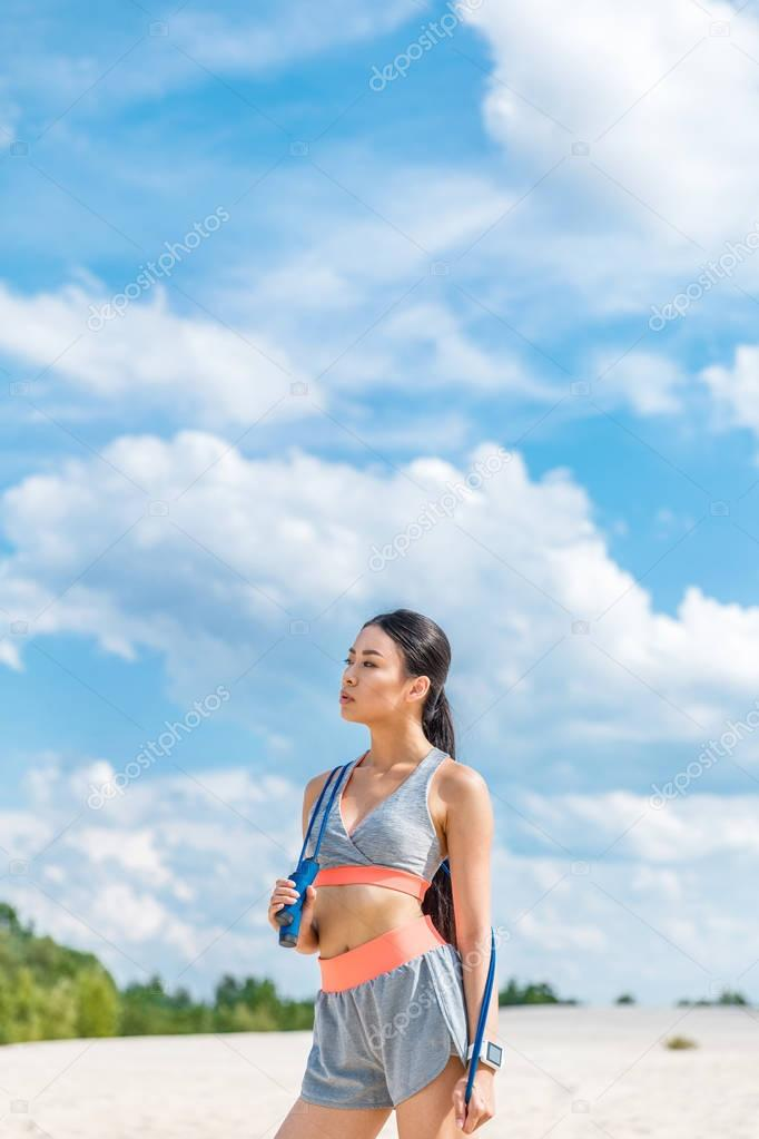sportswoman with jump rope