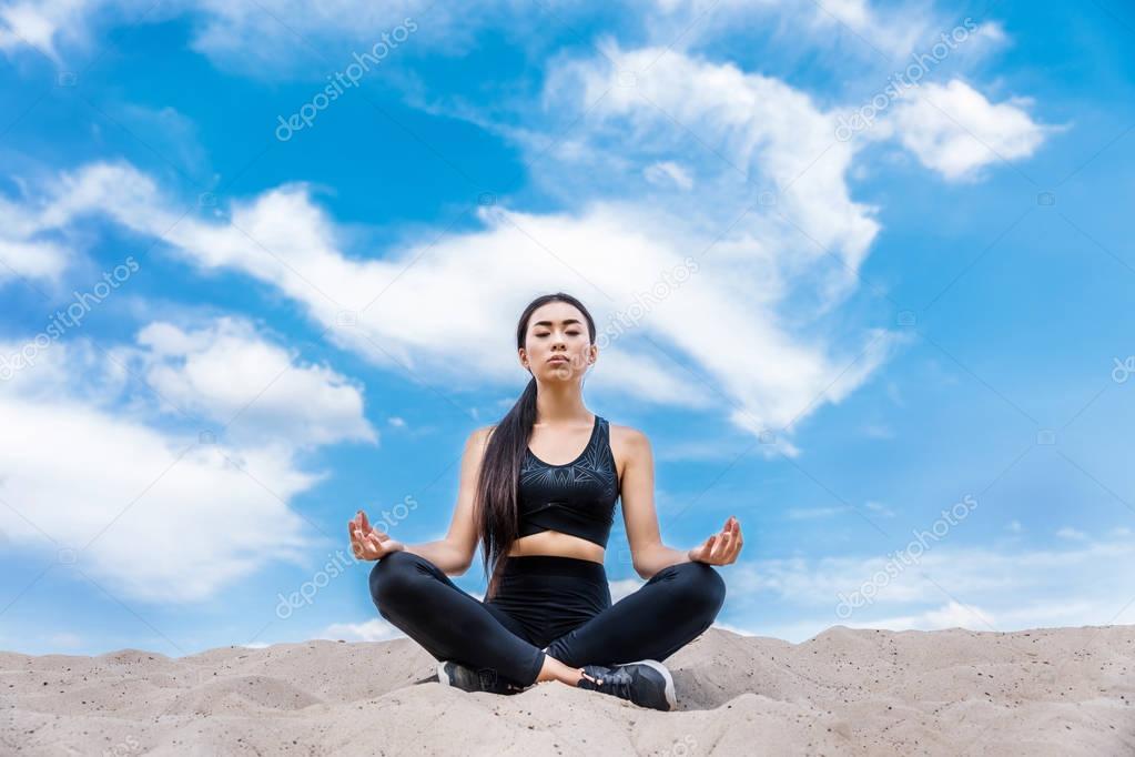 woman meditating in lotus yoga pose