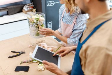 florists working with digital devices