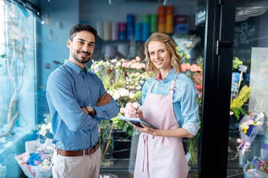 florist and buyer in flower shop