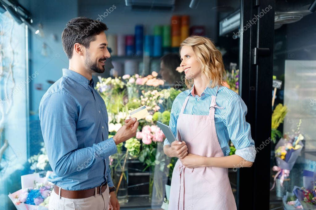 florist and client with credit card