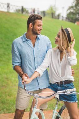 smiling couple with bicycle