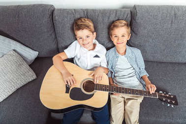 little brothers with guitar