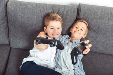 boys playing with joysticks