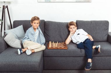little boys playing chess