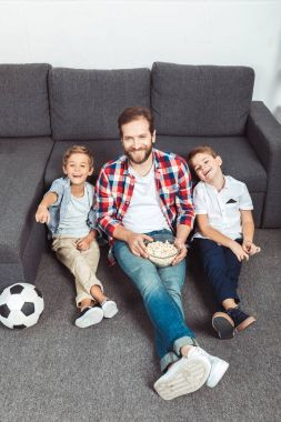 family watching soccer match at home