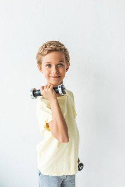 child holding dumbbells