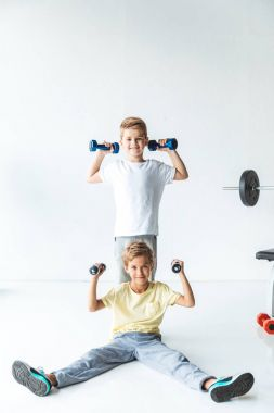 boys exercising with dumbbells
