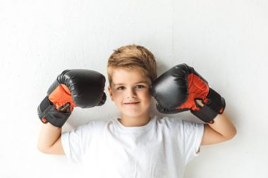 little boy in boxing gloves