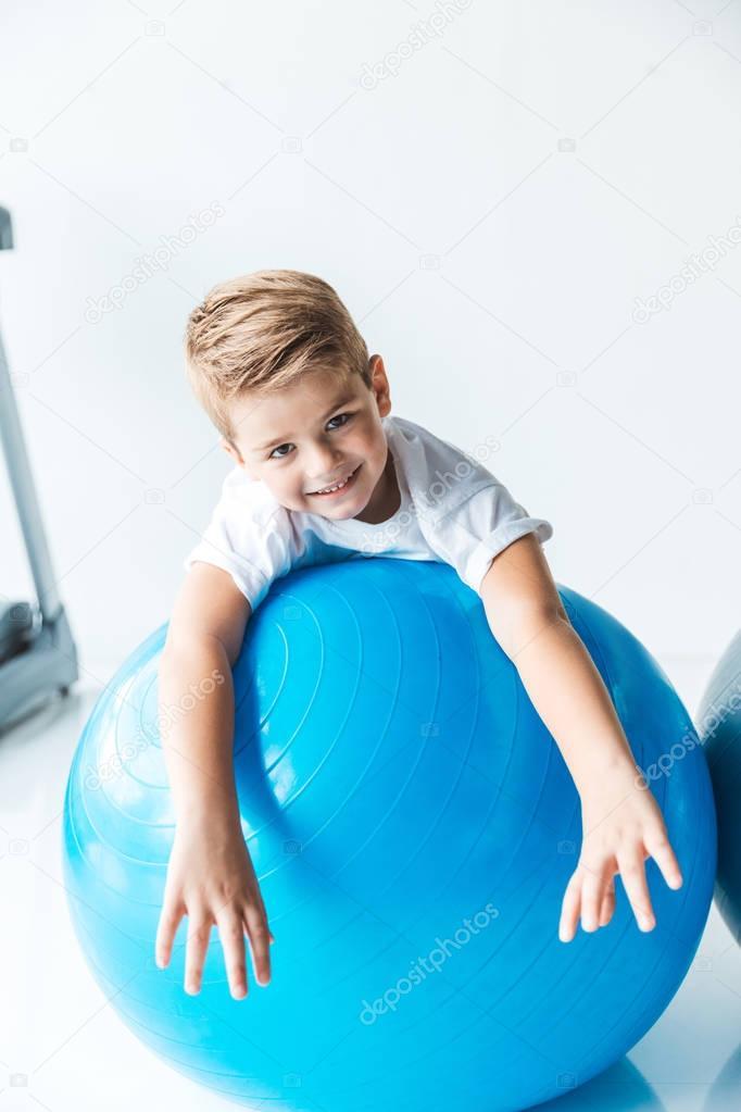 little boy on fitness ball