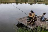 Fotografie Otec a syn rybolov na molu