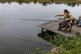 Fotografie otec a syn rybářské pruty