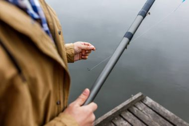 man with fishing rod and hook