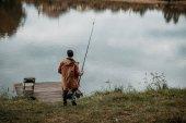 Fotografie Rybář rybolov s tyčinkou
