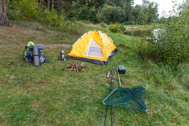 tent on countryside with lake