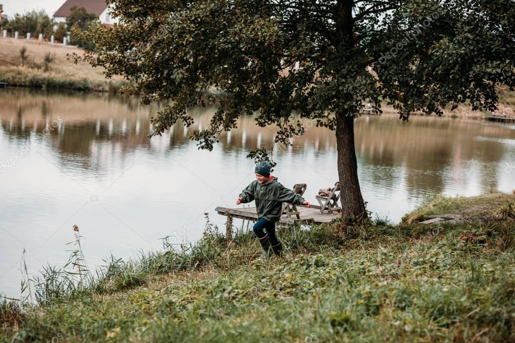 boy playing at lake