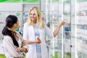 pharmacist consulting customer in drugstore
