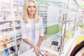 Fotografie payment by credit card in drugstore
