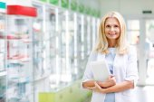 pharmacist with digital tablet in drugstore